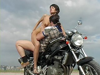 Guy picks gal up and fucks her in mouth and nub on the bike