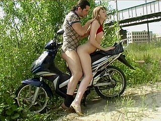 Guy on the motor bike badly owns slutty babe